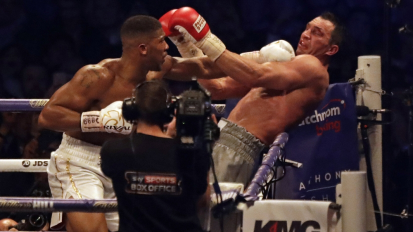 British boxer Anthony Joshua, left, punches Ukrainian boxer Wladimir Klitschko for Joshua's IBF and the vacant WBA Super World and IBO heavyweight titles at Wembley stadium in London, Saturday, April 29, 2017. Joshua won with an 11th round stoppage. (AP Photo/Matt Dunham) ORG XMIT: TH120