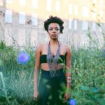 "Jamila Woods releases a spiritually nourishing music video for ""Holy"""
