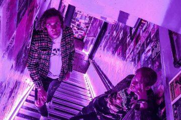 Mates & Trap Toni pose on the steps