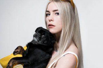 SHY Martin press photo holding a dog